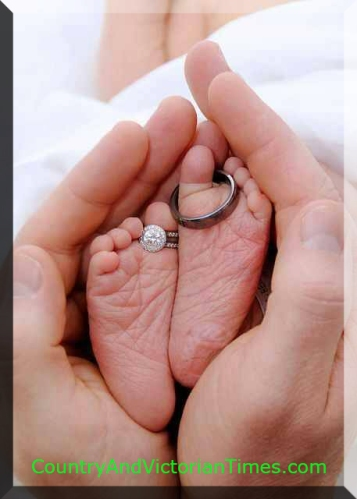 Love this picture of a newborn with the Dad's and Mom's hands to either side and their rings placed on the toes of the wee one. A true symbol of their love.
