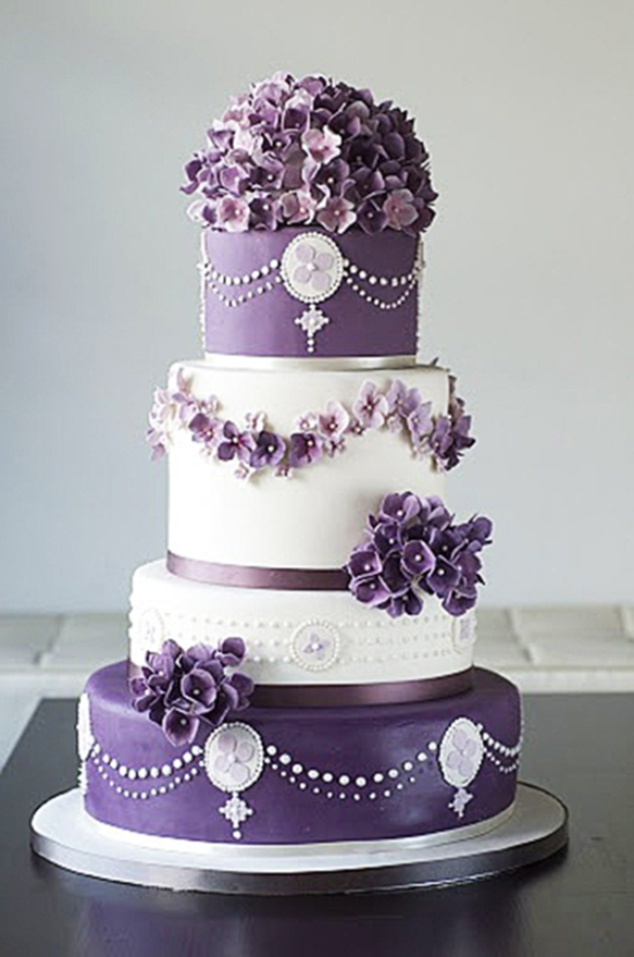Deep-purple-wedding-cake-www.finditforweddings.com-floral-trim